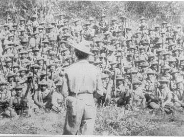 Col. N. Macdonald addressing troops, May 1944