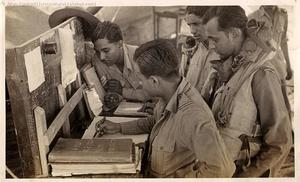 Pilots signing the authorization book on return from a photo recce sortie in 'A' Flight.